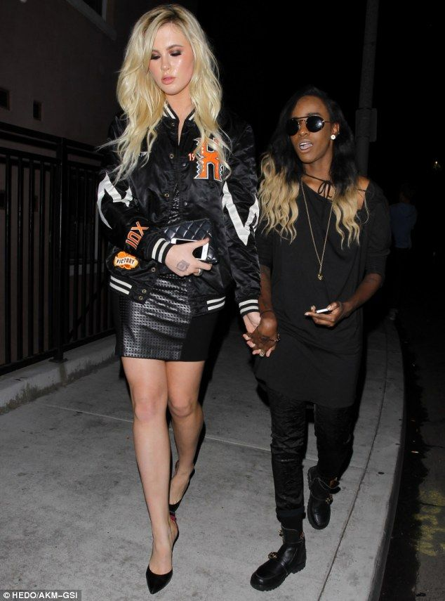 Ireland Baldwin and rumored girlfriend Angel Haze walk hand in hand on their way out of Dirty Laundry in LA on June 11, 2014 http://dailym.ai/1jmHB7K