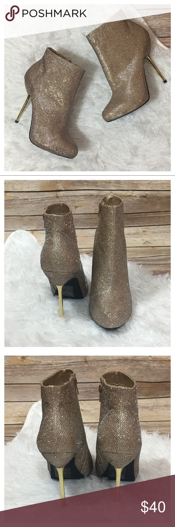 """NWOB Shoe Dazzle Elisabeth Sparkle Pin-Heel Bootie NWOB Shoe Dazzle Elisabeth Sparkle Pin-Heel Bootie - Champagne  This pin-Heel bootie is perfect for holiday parties.   - Size 9.5 - No box - Never worn. Bottoms maybe slightly discolored from shelves. - Gold Heel - Side Zipper - Approximate 5"""" outside heel height   No TRADES. Please use offer button to negotiate. Thanks! Shoe Dazzle Shoes Ankle Boots & Booties"""