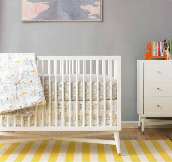 Add a bright citrine rug in bold stripes for a little pattern play in the #ModernBaby's room. #Home #Interiors