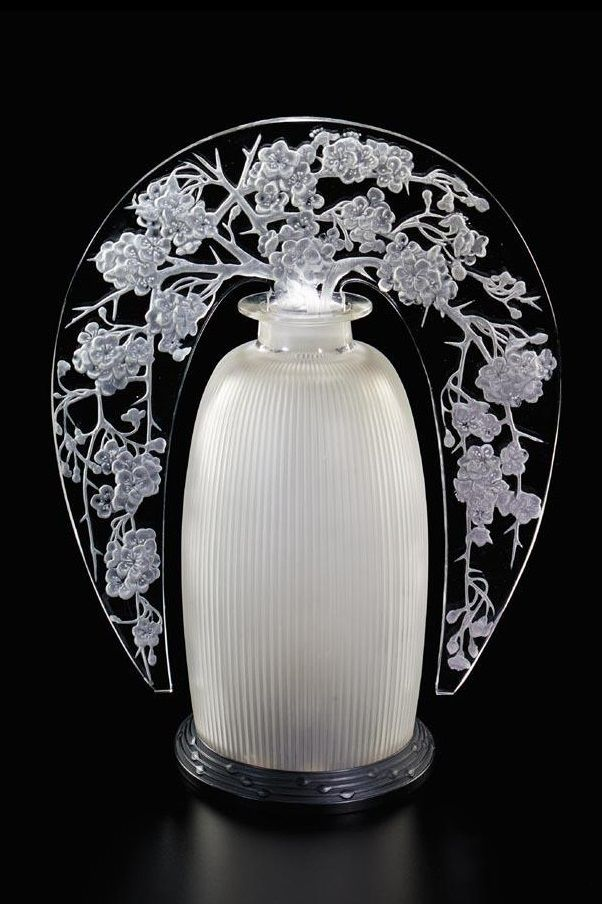 René Lalique 'POMMIER DU JAPON': A GLASS TIARA LAMP the tiara decorated with apple blossoms and supported by an opaque fluted vessel, on stepped bakelite stand the tiara engraved 'R. Lalique France' 42cm.; 1ft. 4½in. designed 1920, (Marcilhac no. 2561)