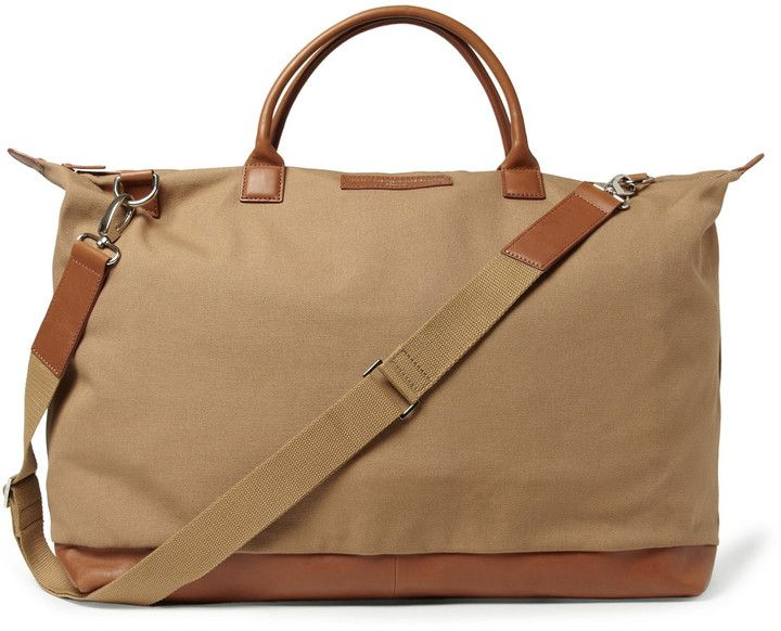 $450, WANT Les Essentiels Hartsfield Leather Trimmed Organic Cotton Canvas Holdall. Sold by MR PORTER. Click for more info: https://lookastic.com/men/shop_items/29740/redirect