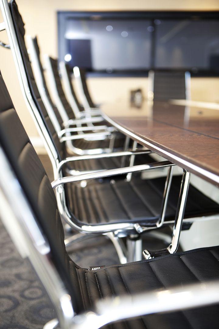 boardroom - aluminium Charles & Ray Eames chair detail