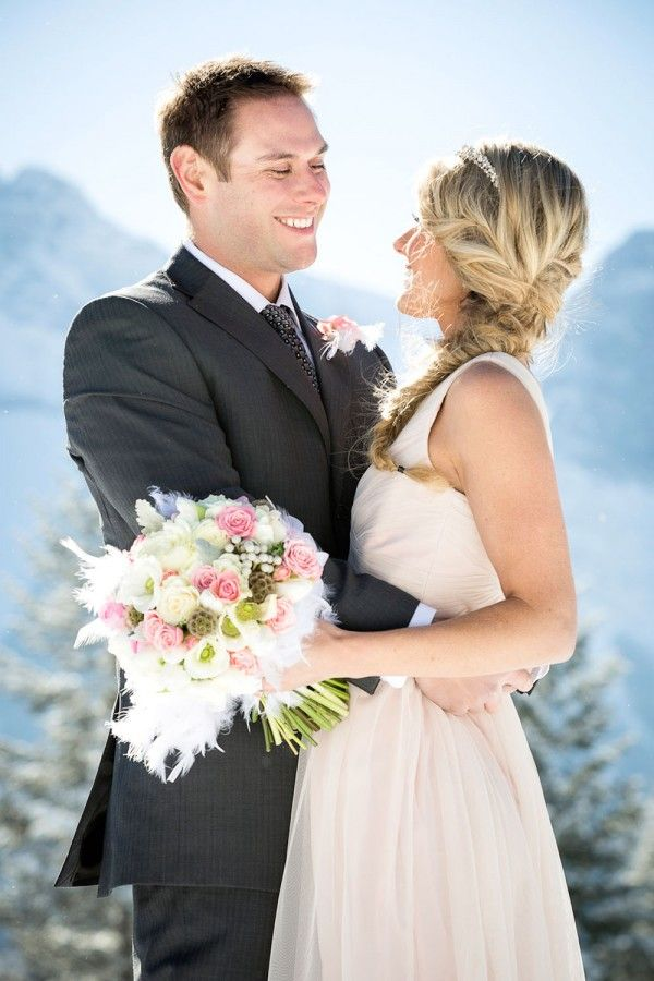 Bride and Groom at Silvertip in Canmore during our Snowy Owl styled shoot featured on weddingbells.ca http://www.weddingbells.ca/real-weddings/a-snowy-owl-themed-wedding-shoot/ Photographer: @Kim Payant Photography  Planning/Decor: @Sharon Auld  Bouquet: Flowers by Janie Calgary & Canmore wedding florist www.flowersbyjanie.com Canmore winter weddings, Rocky weddings