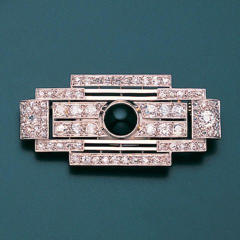 An art deco onyx and diamond brooch, by Raymond Templier, circa 1925 The stepped geometric plaque of openwork design, set throughout with old brilliant and single-cut diamonds and a circular cabochon onyx to the centre, diamonds approximately 3.50 carats total, slightly rubbed signature Raymond Templier, French assay marks, length 5.1cm.