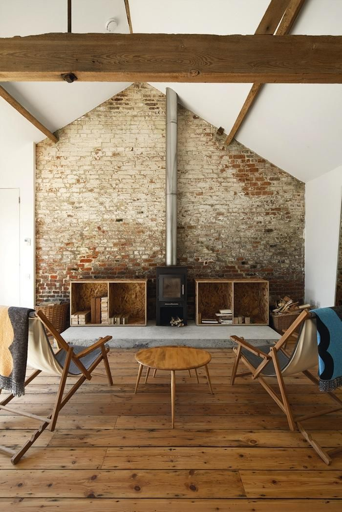 The brick hearth and mantle are surprisingly modern looking in this Norfolk barn by Carl Turner Architects.