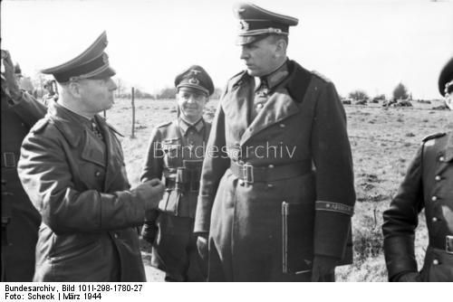 Marshal Erwin Rommel in conversation with Lieutenant General Erwin Menny. March 1944.