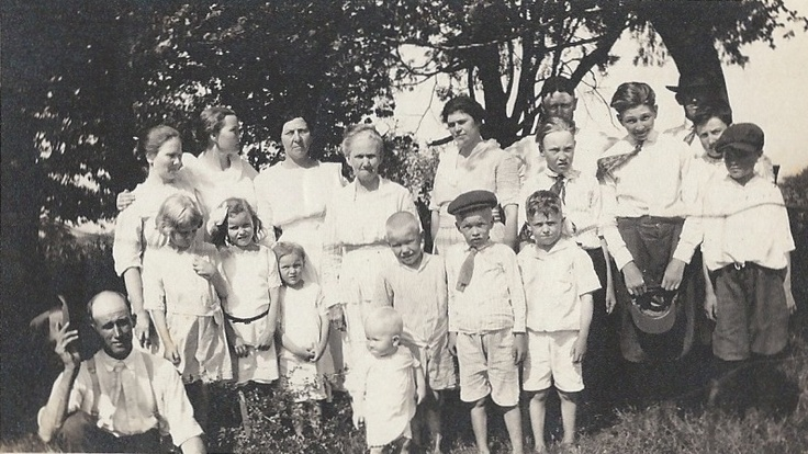 Gillim family and extended family members  Grandparents Simon and Sarah on left. Baby Franklin and his brother Hugh in center. Urey Lee 4th from right with blowing necktie