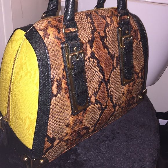 NWOT Aldo Handbag Selling my Aldo snake embossed handbag. Great quality bag with gold zipper and accents. Negotiate using the offer button please. ALDO Bags Hobos