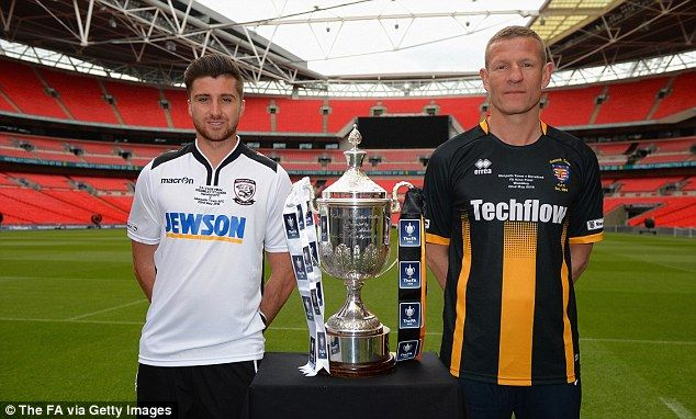 Joel Edwards of Hereford FC and Chris Swailes of Morpeth Town AFC (right) pose with the FA Vase trophy