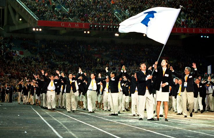 """At the Sydney Olympics, North and South Korea marched together under a """"unification""""flag, turning their backs on conflict for a brief moment."""