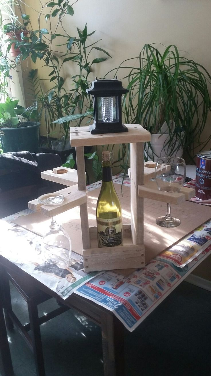 four wine glass holder and wine bottle.great for out doors or in make from pallet wood $50.00
