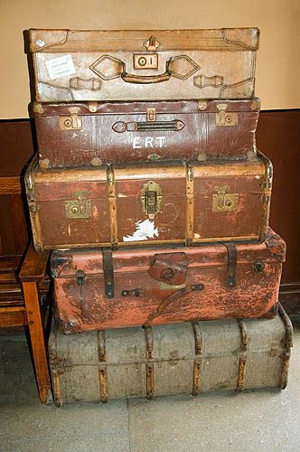 use suitcases to hold our continent box stuff; put a map of the continent on the outside.