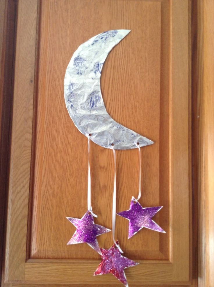 Moon and the Stars Craft - the moon is covered in foil and decorated with glitter glue, stars are card stock with glitter.