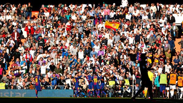 Fans look on in the sunshine during the La Liga match between Real Madrid and Barcelona at Estadio Santiago Bernabeu on December 23, 2017 in Madrid, Spain.