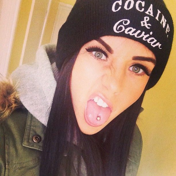 "Pierced hot girl with beanie that says ""Cocaine & Caviar"". Attitude!"