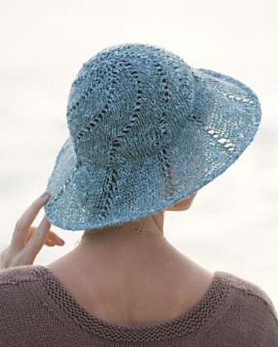 knit a summer hat! would be fab on a head mannequin as a centrepiece