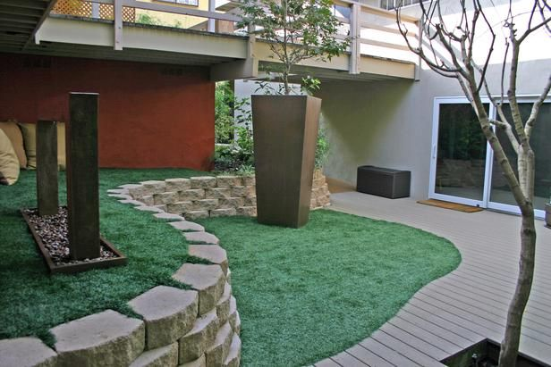 Soothing Japanese Seating Area. The artificial turf provides a place for tots to play. A seating area under the overhang is flanked by a Japanese rain arch that provides soothing sounds and visual interest.