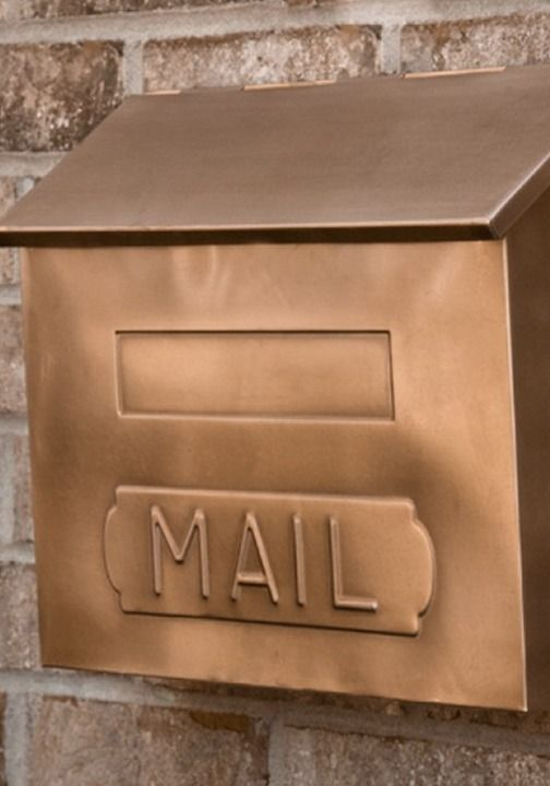 The Antique Copper finish of this wall mount mailbox lends a rustic touch to your home.