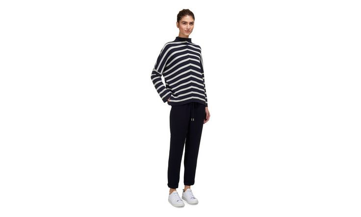 Opt for a staple striped jumper this season. This optical blue and white jumper is best worn oversized. With a relaxed fit, dropped shoulder and contemporary funnel neck. For an smart weekend look pair with cropped tailored trouser and a casual trainer.<br> <br> · Oversized fit<br> · Dropped shoulder<br> · Length (shoulder to hem) 61cm.<br> <br> Marcele is 180cm and wears size S.