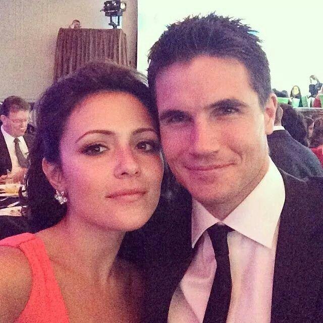 Italia Ricci and Robbie Amell