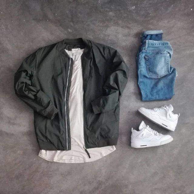 olive bomber. long off-white / tan tee. light wash denim. all white sneakers.
