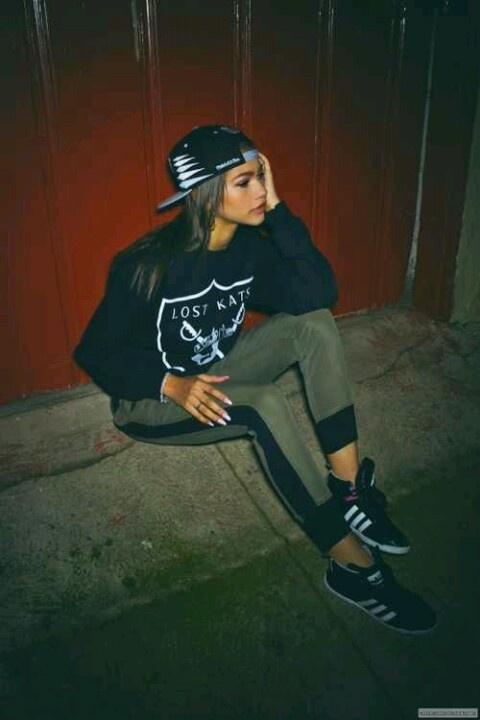 Zendaya (Black Crewneck, Snapback, Olive Skinny Crops, and Black Hightops)