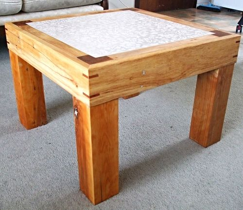 coffee table made from up-cycled pallet wood and a ceramic tile