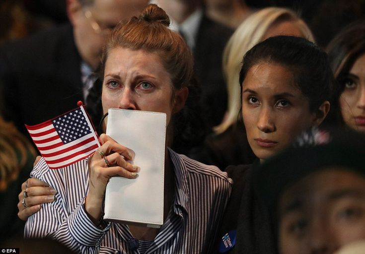 People in the crowd at Hillary Clinton's 2016 US presidential Election Night event watch in tears as results come in on a big screen at the Javits Convention Center