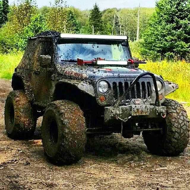 Tricked out muddy Jeep