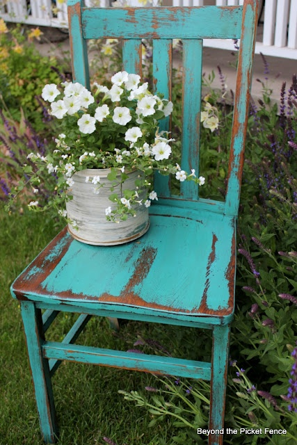 Outdoor decorative chair idea - repaint the black chairs in off white and then sand and let the black through