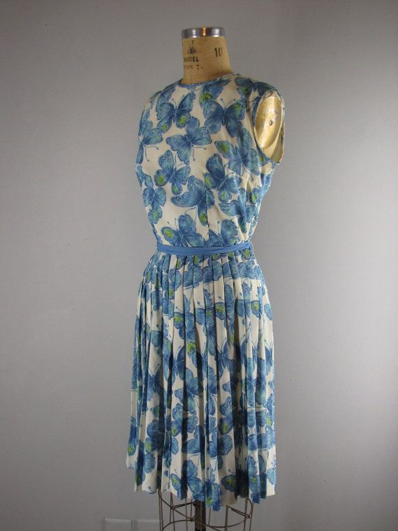 Vintage dress from early 60s is made of a silky poly blend fabric, known as whipped cream which is super easy to care for, as you can just wash it, drip dry and it doesnt wrinkle. Sleeveless dress with pleated skirt. Sash can be tied in front or back. Bodice is lined, skirt is unlined.