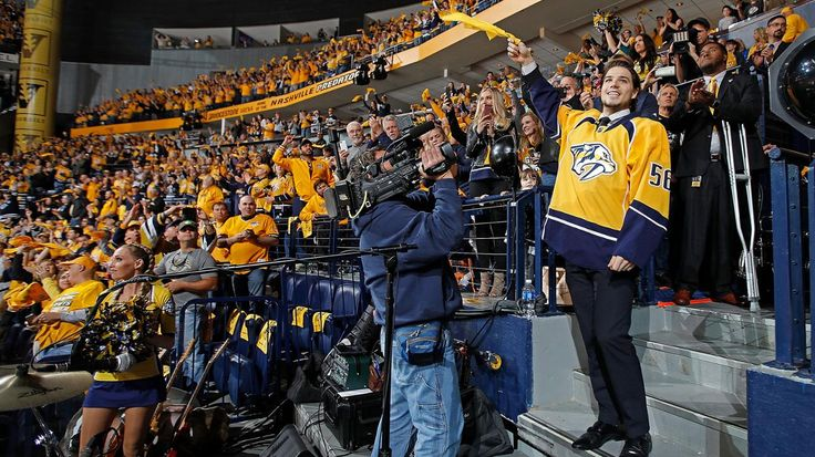 Nashville, TN - May 7: Kevin Fiala #56 of the Nashville Predators waves the towel prior to Game Six of the Western Conference Second Round against the St. Louis Blues during the 2017 NHL Stanley Cup Playoffs at Bridgestone Arena on May 7, 2017 in Nashville, Tennessee.