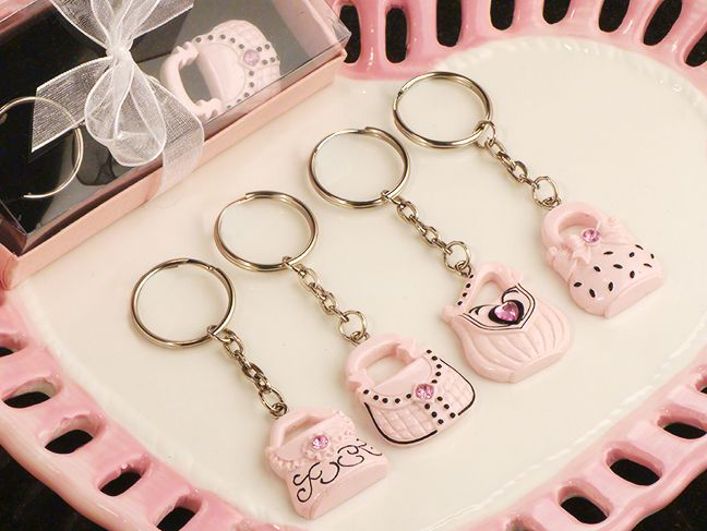 Google Image Result for http://www.hotref.com/category/032109/Oh-so-trendy-pink-and-black-purse-key-chains_6483_r.jpg