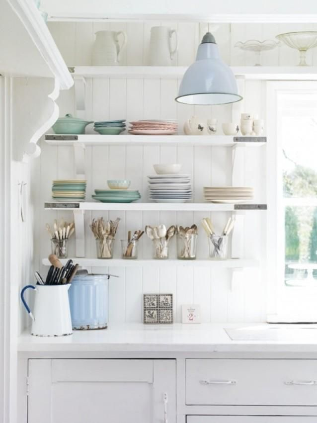 Open shelves, white paint and bits of pastel colored dishes feels like a cottage