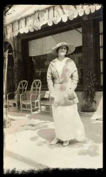 Coco Chanel, Deauville in front of first Chanel store, 1913---