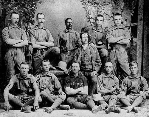 Bud Fowler (center), the earliest known professional black baseball player pictured with one of his teams, the Keokuk, Iowa team of the Western League.  Fowler (born John W. Jackson) is believed to have played from 1878 - 1895.