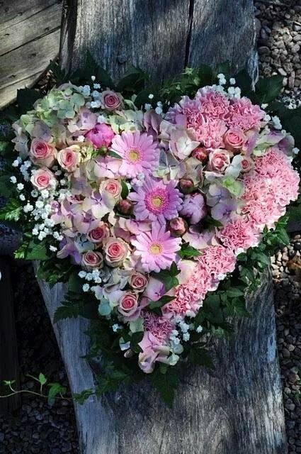 Beautiful heart wreath. Could be made with any flowers you can get, floristry wire and wet foam blocks.