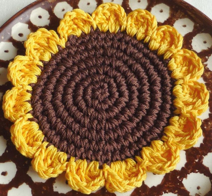 Crochet Sunflower ... by monikadesign | Crocheting Pattern - Looking for your next project? You're going to love Crochet Sunflower Coaster Pattern by designer monikadesign. - via @Craftsy