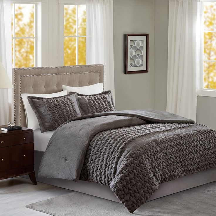 The Ruched Fur Comforter Mini Set by Home Essence is the perfect way to stay warm year round.  The grey comforter features ruching for a beautiful, textured look to your bedding.  Two matching shams with a flange detail complete the set.