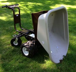 Our Electric Power Wheelbarrow showing off how easy it is to dump whatever you have loaded!