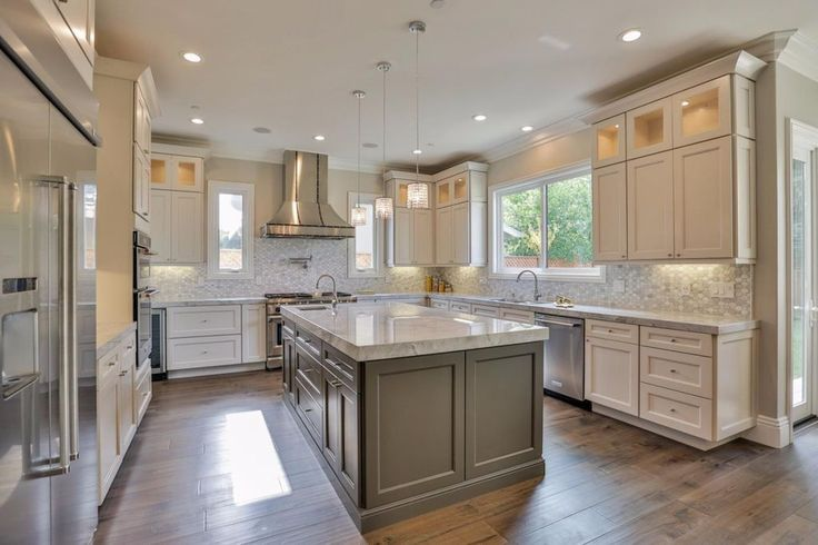 Transitional Kitchen with Penny Tile, High ceiling, Decorative Art Glass Cabinets, Carlisle Wide Plank Flooring Winding Path