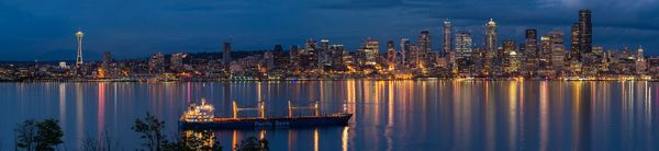 Evening reflection of the Seattle Skyline from Alki Point.
