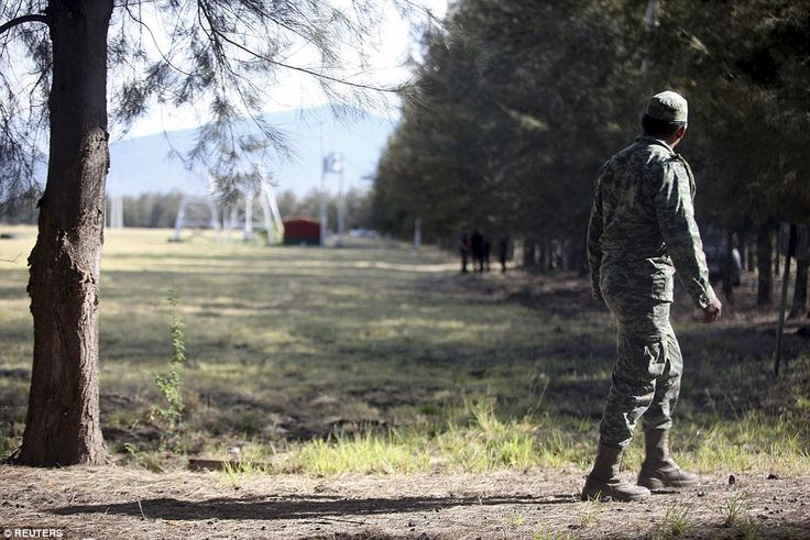 The deadly fighting erupted after a column of federal troops responded to a report about armed gunmen at the ranch in an area where the Jalisco New Generation gang is known to dominate. Above, a soldier walks on the ranch