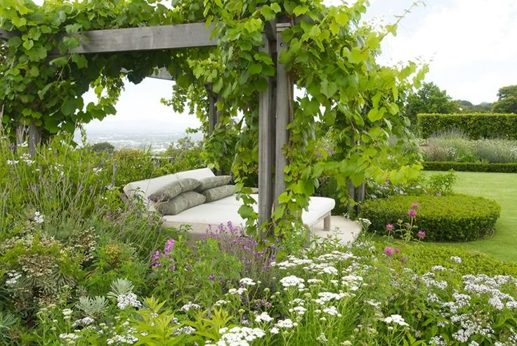 divine day bed under a vine covered pergola by Franchesca Watson | Garden Designer