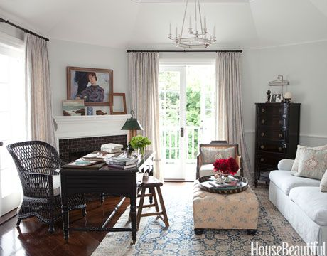 In a Los Angeles home, designer Windsor Smith designed this room to double as a home office and a cozy spot for the family to hang out upstairs.