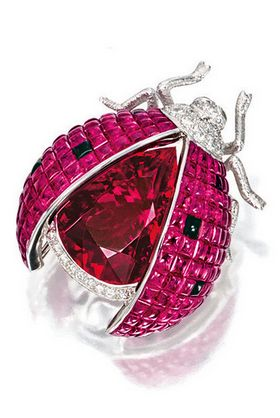 http://rubies.work/0487-sapphire-ring/ PINK TOURMALINE, RUBY, SAPPHIRE AND DIAMOND 'LADYBUG' BROOCH, the body set with a pear-shaped rubellite weighing approx 19.15 carats, the elytra set with calibré-cut rubies highlighted by similarly-set sapphires, the rubies together weighing approxi 24.95 carats, decorated by a brilliant-cut diamond-set head and antennae and circular-cut tsavorite garnet-set eyes, mounted in 18 karat white gold, signed AK.
