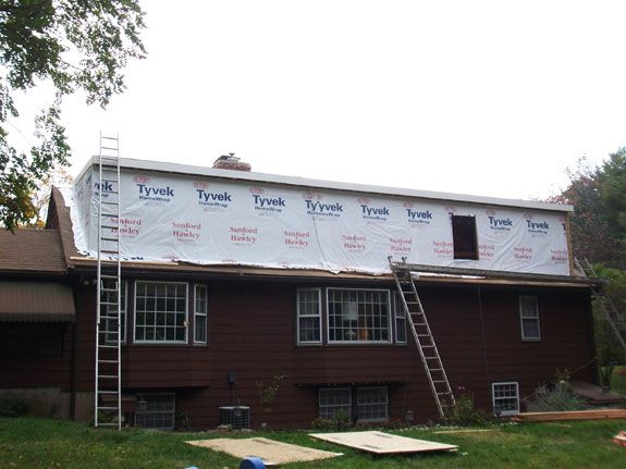Upstairs dormer addition to a ranch. Tyvek house wrap on rear dormer addition