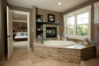Jaccuzi tub with a window view AND fireplace?! Not to mention a beautiful stone front?! Yes, please!