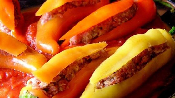 This is an awesome recipe for banana peppers stuffed with an Italian sausage mixture and baked in a delicious tomato sauce. We get requests to make them for the guys my husband works with all the time.