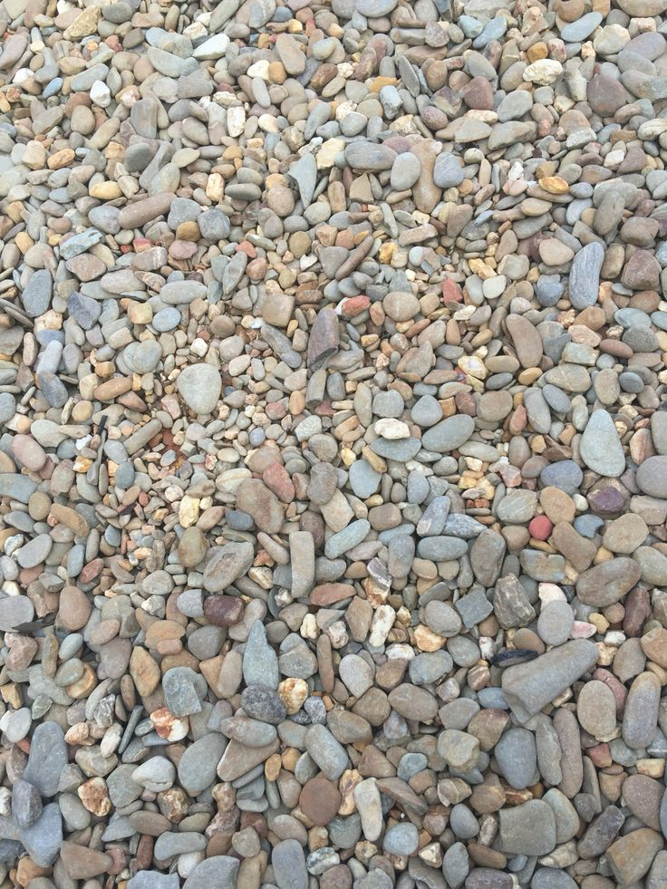 photo 3: In our front yard builder used pebbles for the front area use of these pebbles to protect the soil from rain ,water , dirt and weed . Pebbles looks elegant and it's easy to maintain.